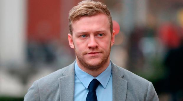 Ireland and Ulster rugby player Stuart Olding arrives at Belfast Crown Court, Photo: Niall Carson/PA Wire