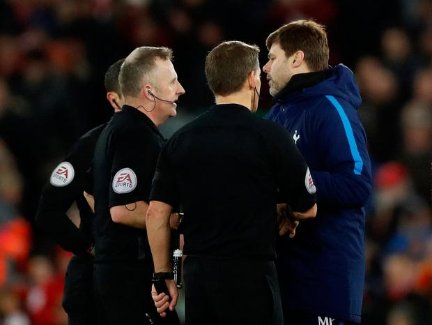 Tottenham manager Mauricio Pochettino shakes hands with referee Jonathan Moss after the match