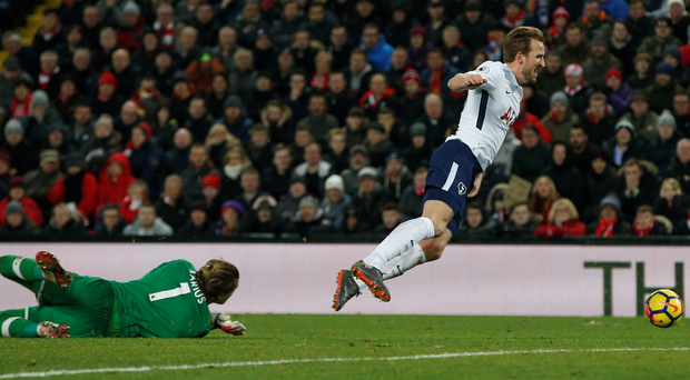 Harry Kane falls to the ground under a challenge from Liverpool goalkeeper Loris Karius. Photo: Reuters