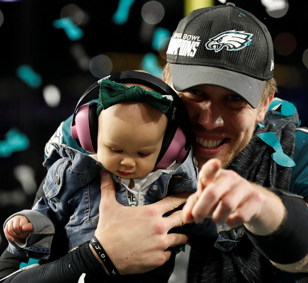 Philadelphia Eagles quarterback Nick Foles celebrates after the Super Bowl victory with his seven-month-old daughter Lily. Photo: Reuters