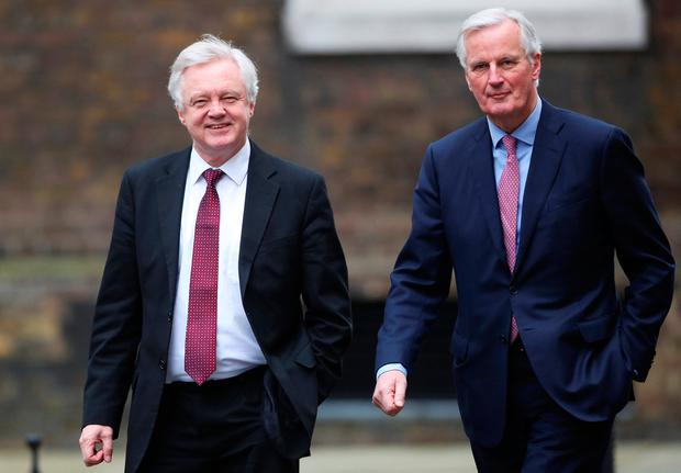 Secretary of State for Exiting the European Union David Davis welcomes the EU's chief Brexit negotiator Michel Barnier to Downing Street in London. Photo: REUTERS/Hannah Mckay