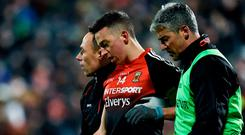 Evan Regan is helped from the field following an injury during Mayo's Allianz Football League Division 1 Round 2 defeat to Kerry in Castlebar. Photo by Seb Daly/Sportsfile