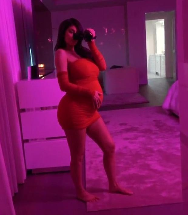 Kylie Jenner cradling her baby bump. Picture: Kylie Jenner/YouTube