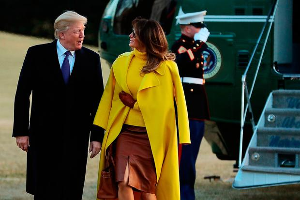 U.S. President Donald Trump (L) and first lady Melania Trump return to the White House after a day trip to Cincinnati, Ohio, February 5, 2018 in Washington, DC