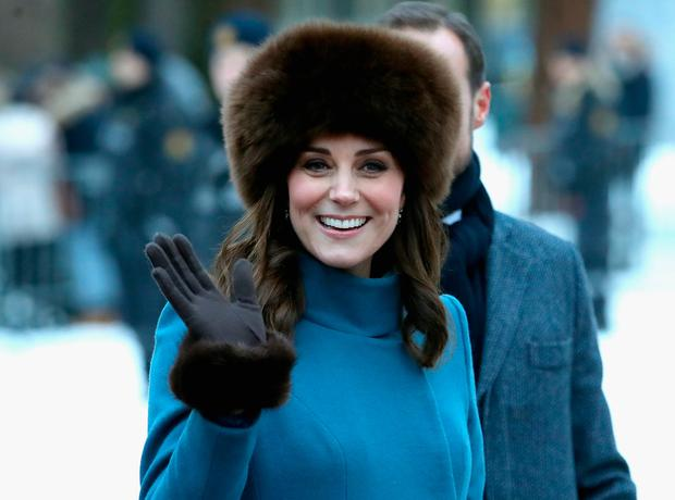 Catherine, Duchess of Cambridge receives flowers as she greets the crowd outside the Royal Palace ahead of visiting the Princess Ingrid Alexandra Sculpture Park on day 3 of her visit to Sweden and Norway on February 1, 2018