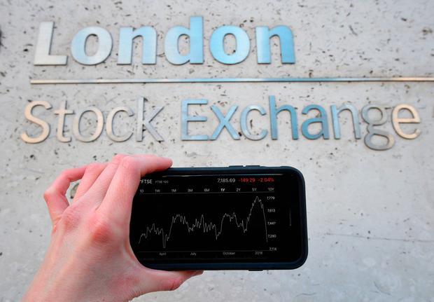 A view of the Stocks app on an iPhone against the London Stock Exchange sign in the City of London Credit: Kirsty O'Connor/PA Wire
