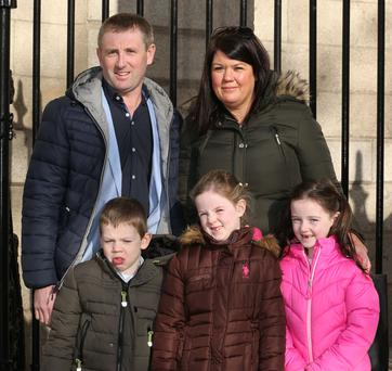 Back Row L-R: Liam and Noelle Tobin pictured with their children, (Front Row L-R:) Billie, Juliet, and Caitriona all from Clonmel, Co. Tipperary leaving the Four Courts today Collins Courts