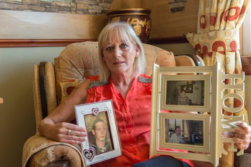 Carmel Kidney, Ballincollig, Cork holds photos of her deceased sons Pic Michael Mac Sweeney/ Provision