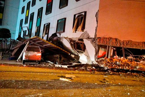 A damaged vehicle stands in rubble outside the Marshal Hotel in Hualien, eastern Taiwan early February 7, 2018, after a strong earthquake struck the island. A hotel on the east coast of Taiwan has collapsed after a 6.4-magnitude earthquake, the government said. / AFP PHOTO / PAUL YANG / Taiwan OUTPAUL YANG/AFP/Getty Images