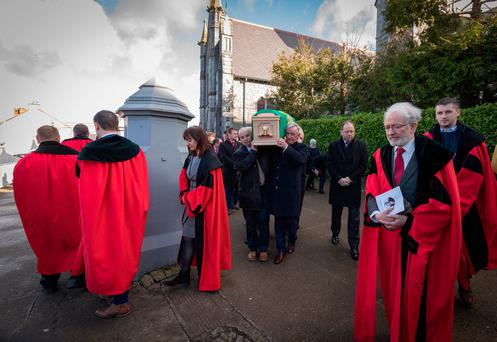 President Michael D Higgins and former Tánaiste Joan Burton were among the mourners at the funeral of Séamus Pattison. Pictures: Dylan Vaughan