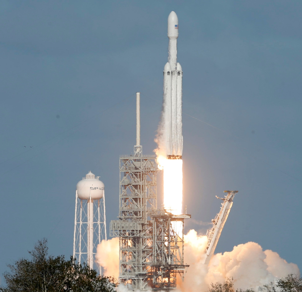 Liff-off for SpaceX Falcon Heavy. Inset: Elon Musk