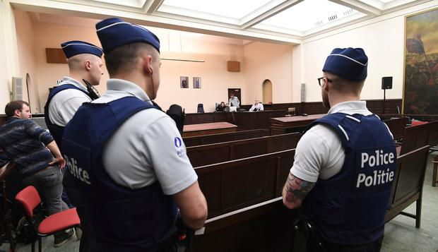 Police officers guard the courtroom during the trial of Salah Abdeslam at the Brussels Justice Palace. Photo: AP