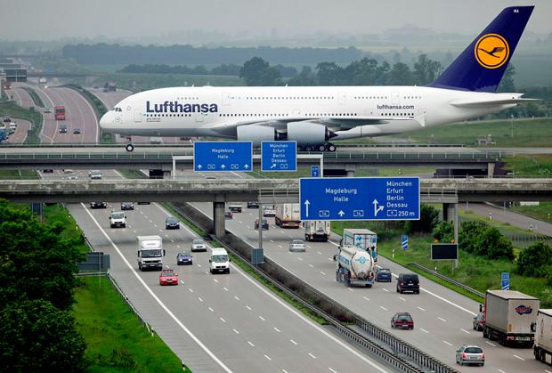 A lufthansa Airbus A380 rolls over a bridge at Leipzig Airport. Photo: JAN WOITAS/AFP/Getty Images