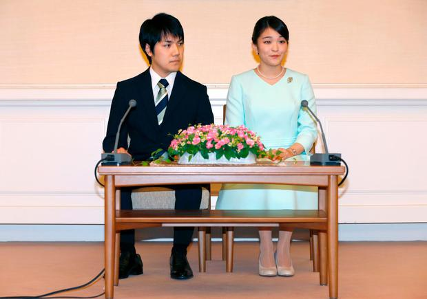 Princess Mako (R), the eldest daughter of Prince Akishino and Princess Kiko, and her fiancee Kei Komuro (L), take part in a press conference to announce their engagement at the Akasaka East Residence in Tokyo on September 3, 2017. Emperor Akihito's eldest granddaughter Princess Mako and her fiancé -- a commoner -- announced their engagement on September 3, which will cost the princess her royal status in a move that highlights the male-dominated nature of Japan's monarchy. / AFP PHOTO / POOL / Shizuo Kambayashi (Photo credit should read SHIZUO KAMBAYASHI/AFP/Getty Images)