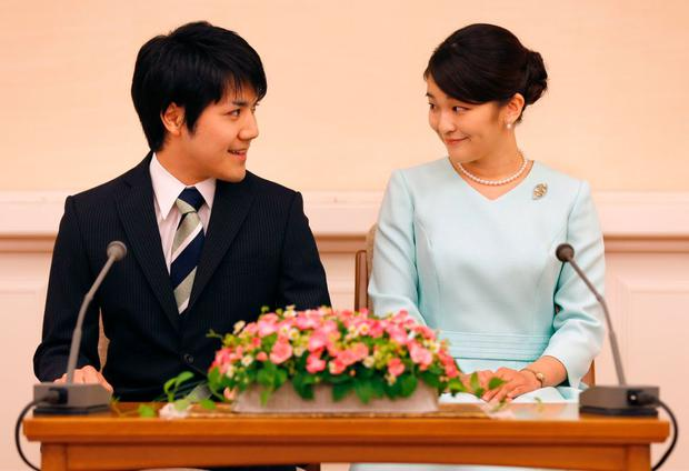 Princess Mako (R), the eldest daughter of Prince Akishino and Princess Kiko, and her fiancee Kei Komuro (L), smile during a press conference to announce their engagement at the Akasaka East Residence in Tokyo on September 3, 2017. Emperor Akihito's eldest granddaughter Princess Mako and her fiancé -- a commoner -- announced their engagement on September 3, which will cost the princess her royal status in a move that highlights the male-dominated nature of Japan's monarchy. / AFP PHOTO / POOL / Shizuo Kambayashi (Photo credit should read SHIZUO KAMBAYASHI/AFP/Getty Images)