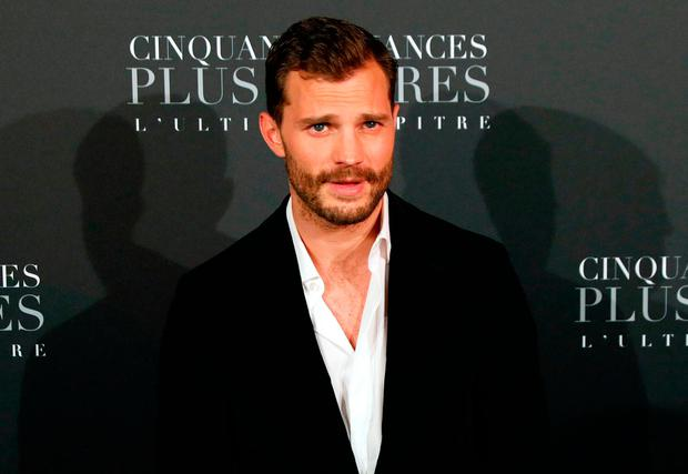 Actor Jamie Dornan poses as he arrives to attend 'Fifty Shades Freed - 50 Nuances Plus Claires' Premiere at Salle Pleyel in Paris on February 6, 2018. / AFP PHOTO / PATRICK KOVARIKPATRICK KOVARIK/AFP/Getty Images