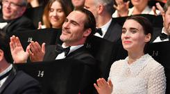 CANNES, FRANCE - MAY 28: Joaquin Phoenix (L) and Rooney Mara applaud during the Closing Ceremony of the 70th annual Cannes Film Festival at Palais des Festivals on May 28, 2017 in Cannes, France. (Photo by Pascal Le Segretain/Getty Images)