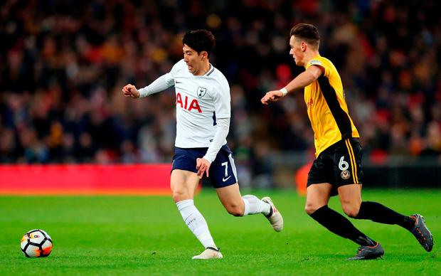 Tottenham Hotspur's Son Heung-Min and Newport County's Ben White battle for the ball. Photo: Adam Davy/PA Wire