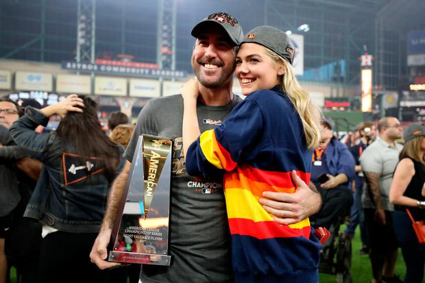 Justin Verlander #35 of the Houston Astros celebrates with model Kate Upton and the MVP trophy after defeating the New York Yankees by a score of 4-0 to win Game Seven of the American League Championship Series at Minute Maid Park on October 21, 2017