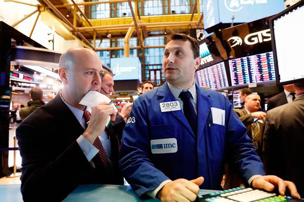 Traders react near the end of the day on the floor of the New York Stock Exchange in New York