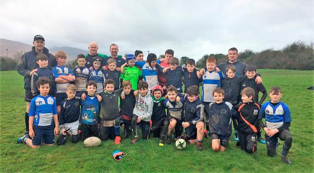 A bunch of enthusiastic participants from Tralee RFC minis with their coaches
