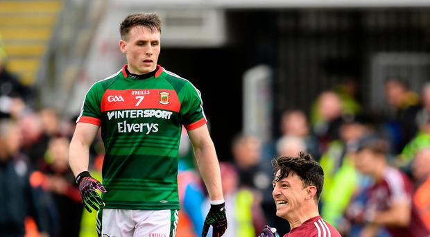 Galway's Seán Armstrong celebrates in front of Mayo's Paddy Durkan after last year's Connacht SFC semi-final. Photo: Sportsfile