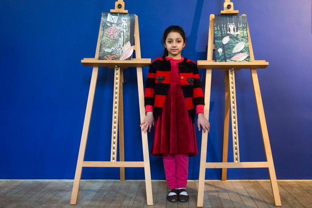 Fatima Malik with artwork from 'Blueprints', an exhibition of work by children of the asylum-seeking community at the Lewis Glucksman Gallery, University College Cork Photos: Clare Keogh