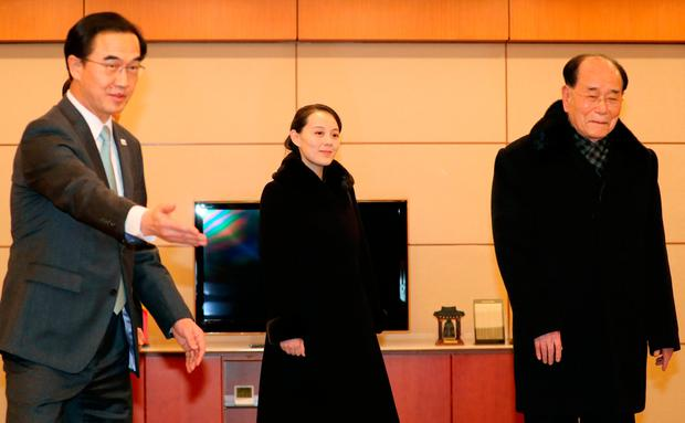 Kim Yo Jong, center, sister of North Korean leader Kim Jong Un, and the country's nominal head of state Kim Yong Nam, right, arrive as South Korean Unification Minister Cho Myoung-gyon, left, at Incheon International Airport in Incheon, South Korea, Friday, Feb. 9, 2018. A high-level North Korean government delegation including leader Kim Jong Un's sister has arrived in South Korea to attend the opening ceremony of the Pyeongchang Winter Olympics. (Kim Ju-hyung/Yonhap via AP)