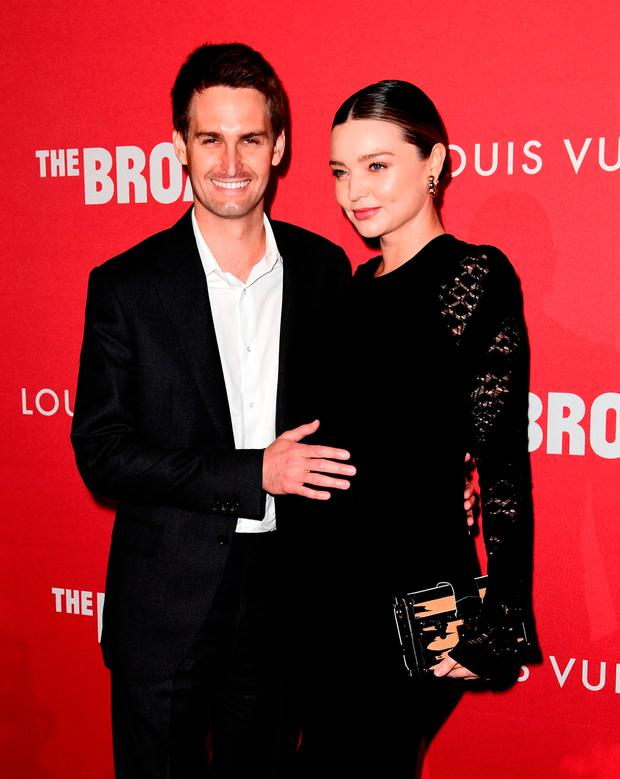 Evan Spiegel (L) and Miranda Kerr attend The Broad and Louis Vuitton's celebration of Jasper Johns: