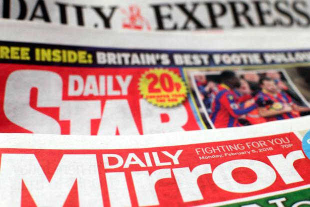 Newspaper publisher Trinity Mirror has agreed a £126.7 million deal to buy a string of Northern & Shell titles including the Daily Express and Daily Star. Yui Mok/PA Wire