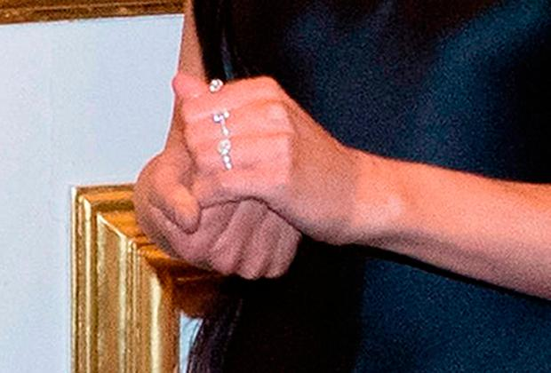 Close up of the hands of former Girls Aloud star Cheryl as she meets the Prince of Wales at an Invest in Futures reception for The Prince's Trust at St James's Palace in London