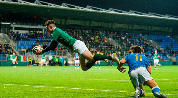 James McCarthy of Ireland catches a high ball ahead of Tommaso Coppo of Italy to score his side's fourth try during the U20 Six Nations Rugby Championship match between Ireland and Italy at Donnybrook Stadium, in Dublin. Photo by Piaras Ó Mídheach/Sportsfile