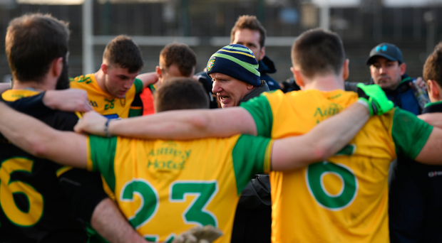 Declan Bonner speaks to his players before the game against Kerry. Photo: Sportsfile
