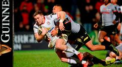 Darren Cave of Ulster on his way to scoring his side's eight try despite the tackle of Godlen Masimla of Southern Kings during the Guinness PRO14 Round 14 match between Ulster and Southern Kings at Kingspan Stadium in Belfast. Photo by Oliver McVeigh/Sportsfile