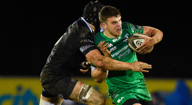 Connacht's Tom Farrell is tackled by Ospreys' James King. Photo: Sportsfile
