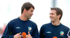 Roy Keane chats to team-mate Liam Miller