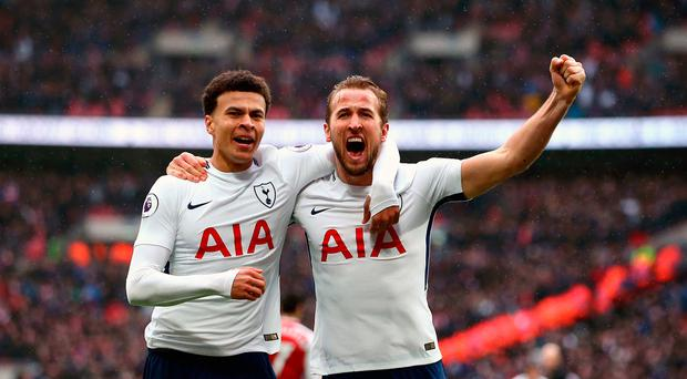 Tottenham Hotspur's Harry Kane celebrates scoring his side's first goal of the game with Dele Alli (left) during the Premier League match at Wembley Stadium, London. John Walton/PA Wire. R