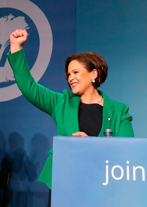 Mary Lou McDonald acknowledges the applause of delegates as she is elected as Sinn Fein's president at the party's special conference at the RDS in Dublin. Photo: Niall Carson/PA Wire