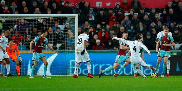 Soccer Football - Premier League - Swansea City vs Burnley - Liberty Stadium, Swansea, Britain - February 10, 2018 Swansea City's Ki Sung Yueng scores their first goal. Action Images via Reuters/Andrew Boyers