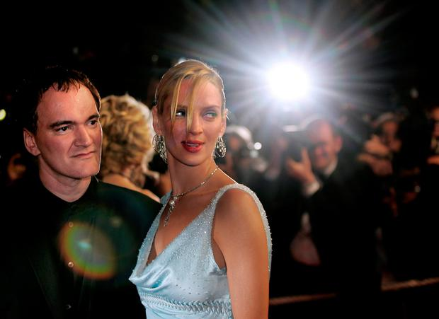 Tarantino with Thurman on the red carpet for Kill Bill. Photo: AFP