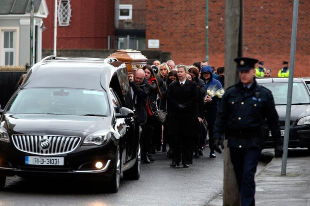 Victim: The funeral procession ahead of the service for Jason Molyneux. Photo: Tony Gavin