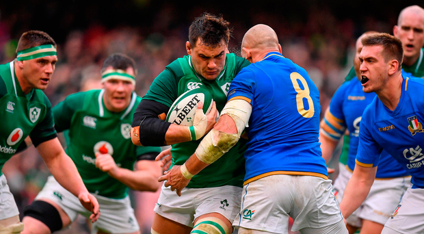 Quinn Roux of Ireland is tackled by Sergio Parisse of Italy