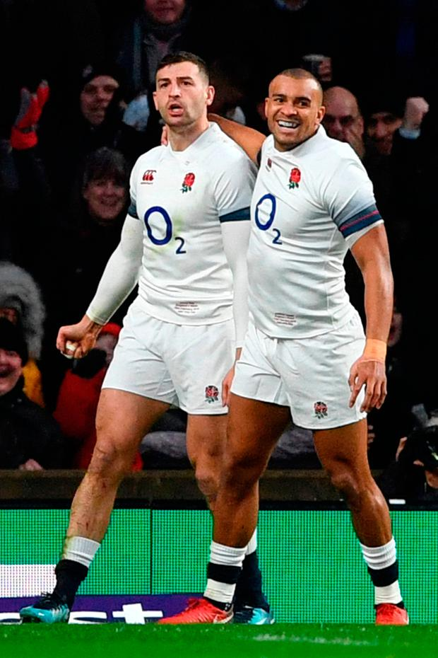 England's wing Jonny May celebrates scoring a try against Wales
