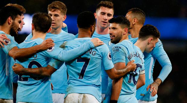 Manchester City's Sergio Aguero celebrates scoring their fifth goal with teammates