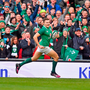 Jacob Stockdale runs in to score Ireland's eighth try against Italy at the Aviva Stadium yesterday. Photo: Sportsfile