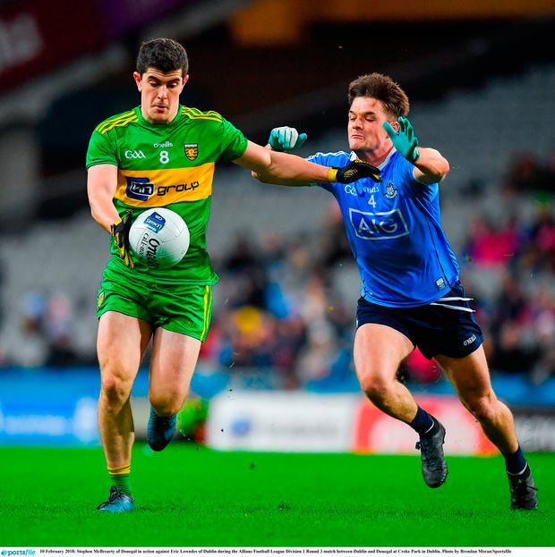 Stephen McBrearty of Donegal in action against Eric Lowndes of Dublin