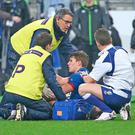 Antoine Dupont is treated on the pitch before being substituted against Ireland last week. Photo: Getty Images