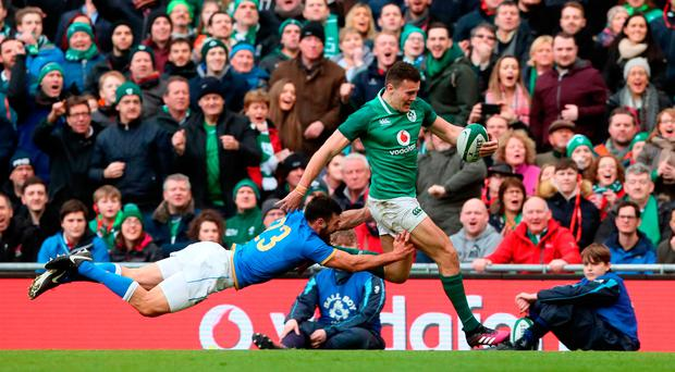 Ireland's Jacob Stockdale (right) breaks away from Italy's Jayden Hayward to score his sides eighth try during yesterday's Six Nations match. Reading of sports pages and newspapers over the last 12 to 18 months, King believes the language of war is more likely to be invoked in rugby as opposed to any other sport. Photo: Brian Lawless/PA