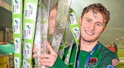 Kieran Sadlier of Cork City celebrates with the SSE Airtricity League Premier Division trophy. Photo: Sportsfile