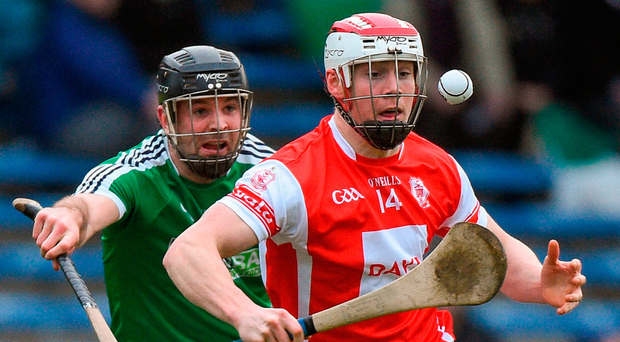 Con O'Callaghan of Cuala in action against David Collins of Liam Mellows in Semple Stadium yesterday. Photo: Matt Browne/Sportsfile